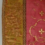 German medieval silk stocking decorated with yellow silk and gold embroidery.